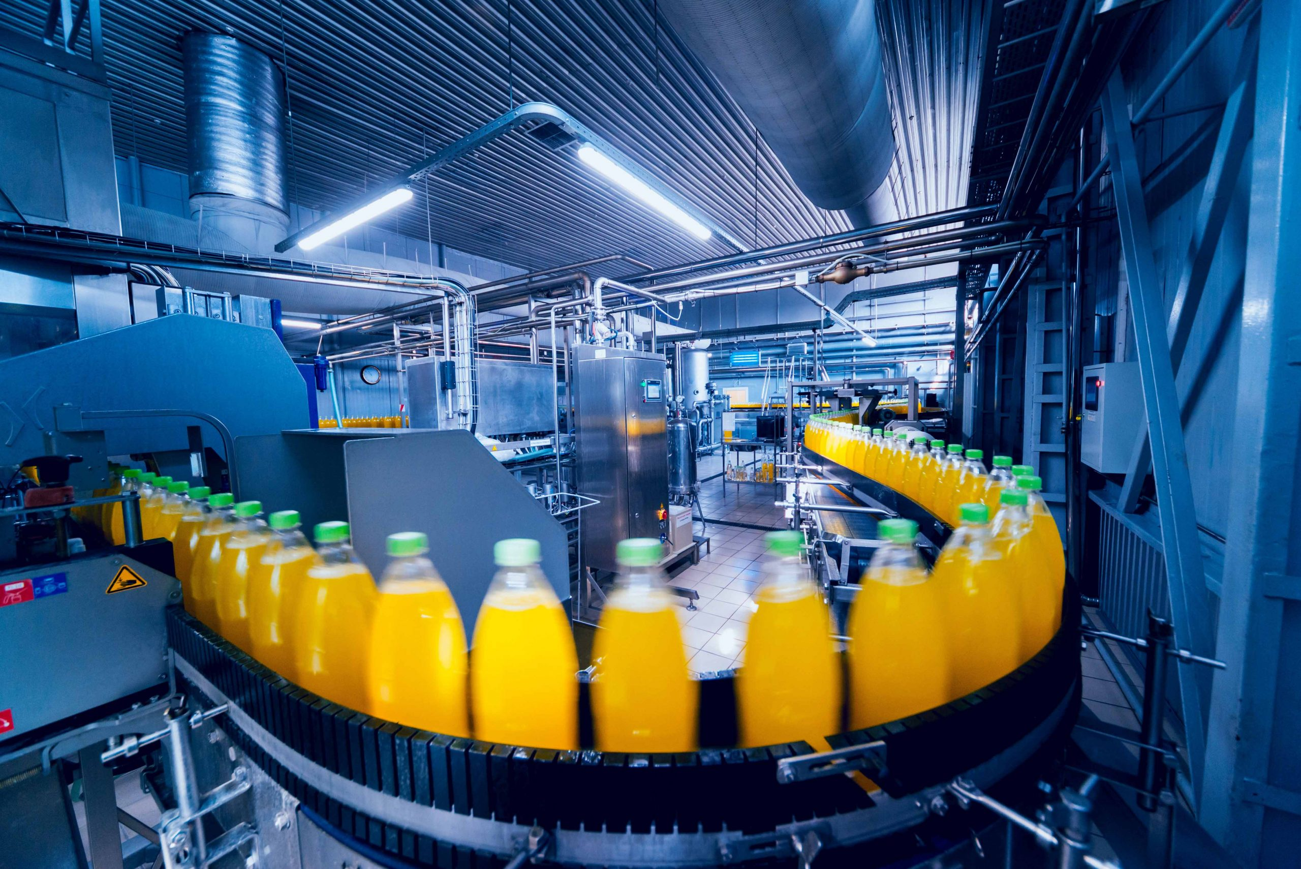 Beverage factory interior. Conveyor with bottles for juice or water. Modern equipments